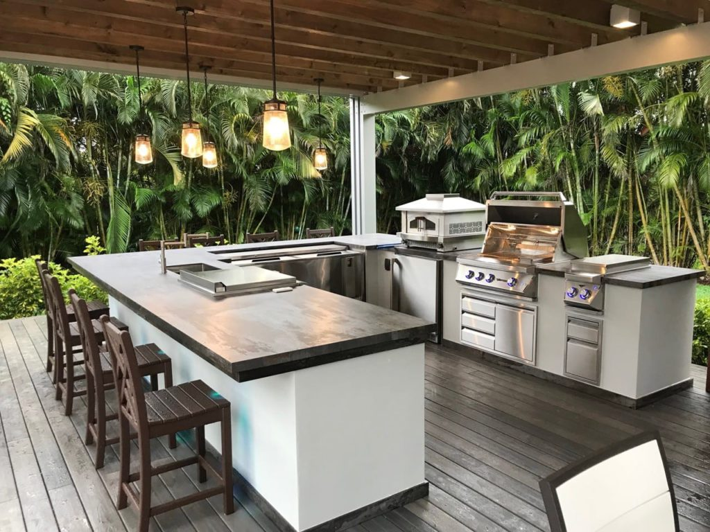 a patio with a fully functional kitchen
