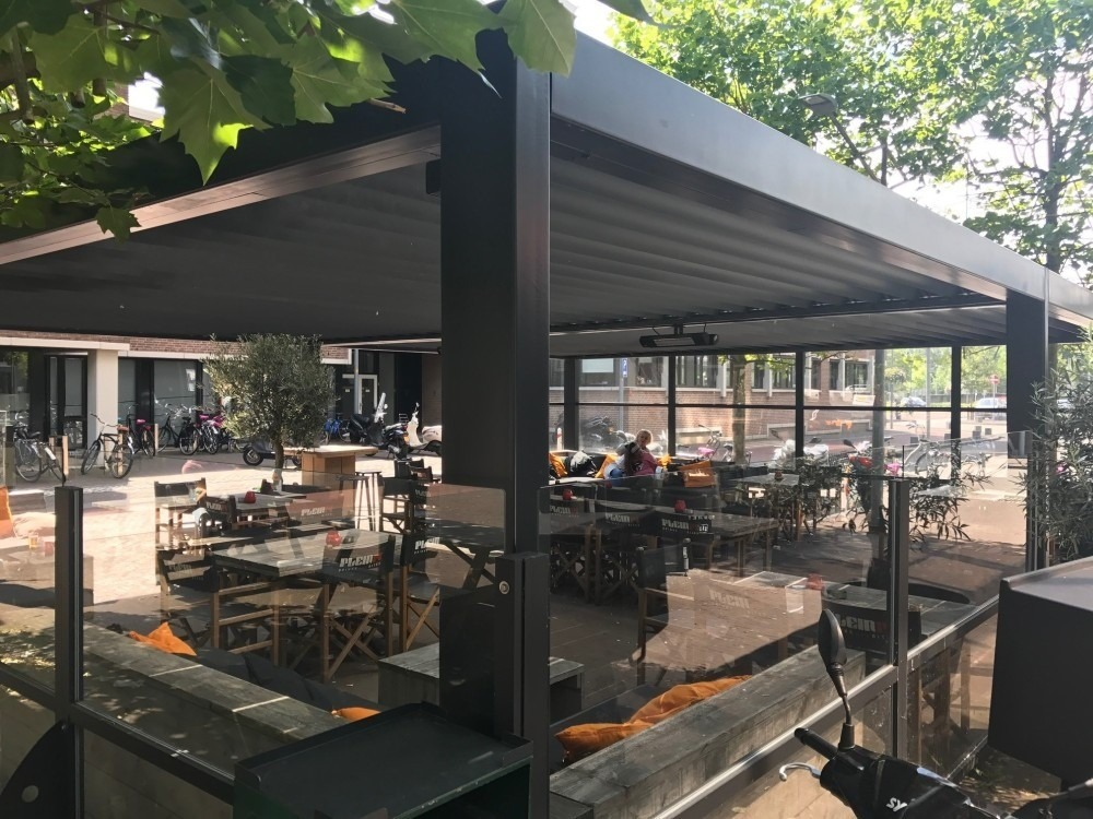 an example of a restaurant with a free standing pergola in Netherlands